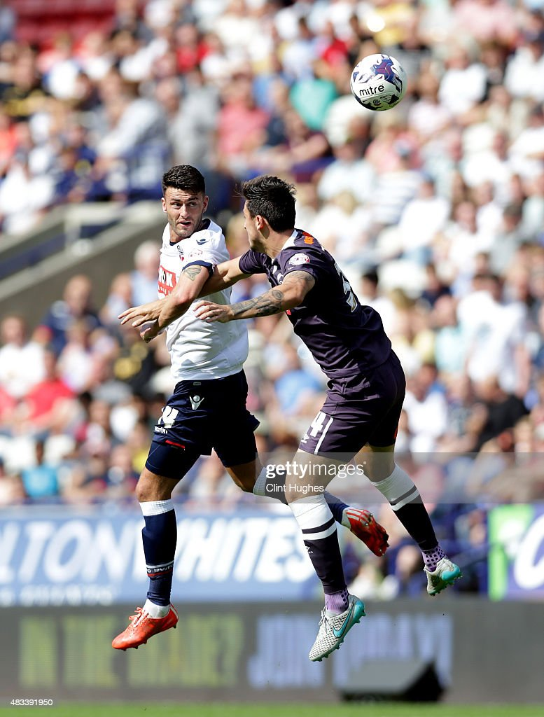 Gary Madine (L) of Bolton Wanderers and George Thorn of Derby County contest a header during the Sky Bet Championship match between Bolton Wanderers and Derby County at the Macron Stadium on August 8, 2015 in Bolton, England.