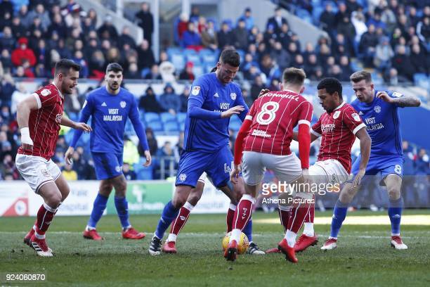 Gary Madine of Cardiff City struggles to find space as he is marked by Josh Brownhill of Bristol City during the Sky Bet Championship match between...
