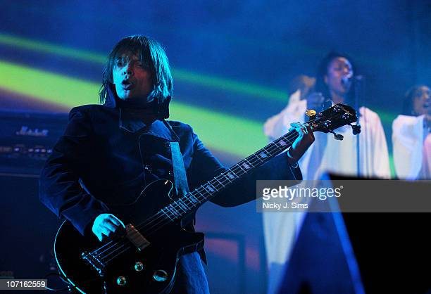 Gary 'Mani' Mounfield of Primal Scream performs on stage during the opening night of the anniversary performances of their seminal 1991 album...