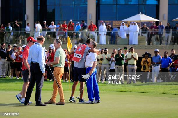Gary Marks of England and Chris Williams of South Africa shake hands during the playoff in the final round of the Sharjah Senior Golf Masters played...