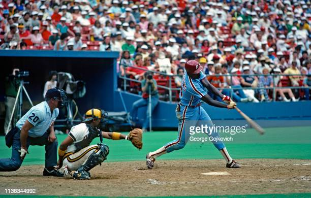 Gary Matthews of the Philadelphia Phillies bats as catcher Tony Pena of the Pittsburgh Pirates and umpire Ed Vargo look on during a Major League...