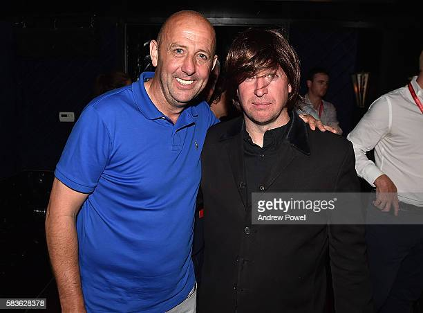 Gary McAllister ambassador of Liverpool poses for a photo with Robbie Fowler in a Beatle wig during a visit to a supporters club on July 26 2016 in...