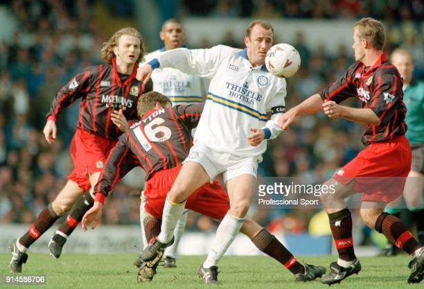 Gary McAllister of Leeds United is closed down by Chris Sutton and Alan Shearer both of Blackburn Rovers during an FA Carling Premiership match at...