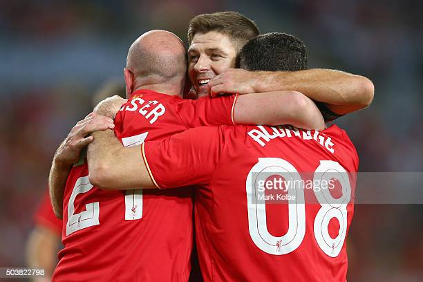 Gary McAllister Steven Gerrard and John Aldridge of the Liverpool FC Legends celebrate after John Aldridge of the Liverpool FC Legends scored a goal...
