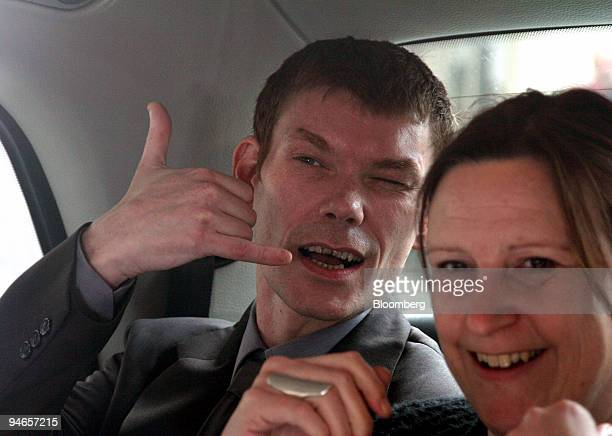 Gary McKinnon gestures as he leaves Bow Street Magistrates Court with an unidentified woman in London UK on Wednesday April 12 2006 McKinnon is...