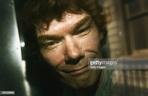 Gary McKinnon leaves Bow Street Magistrate Court in a police van after being released on bail June 8 2005 in London England Mr McKinnon known on the...