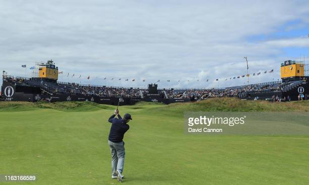 Gary McNeil the Royal Portrush Golf Club Head Professional playing as a noncompeting marker for Paul Waring in the first match plays his second shot...