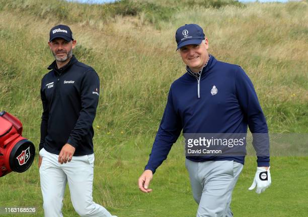 Gary McNeil the Royal Portrush Golf Club Head Professional playing as a noncompeting marker for Paul Waring in the first match walks off the 18th tee...
