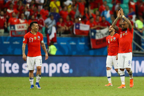 Gary Medel and Arturo Vidal of Chile celebrate a victory after the Copa America Brazil 2019 group C match between Ecuador and Chile at Arena Fonte...