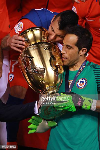 Gary Medel and Claudio Bravo of Chile celebrate with the trophy after winning the championship match between Argentina and Chile at MetLife Stadium...