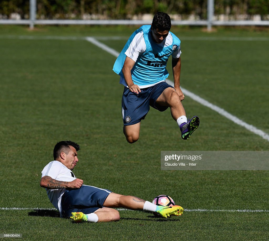 Gary Medel (L) and Dodo compete for the ball during the FC Internazionale training session at the club's training ground at Appiano Gentile on August 11, 2016 in Como, Italy.