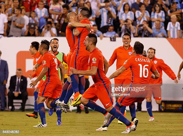 Gary Medel and Francisco Silva of Chile celebrate the win during penalty shootout in the championship match between Argentina and Chile at MetLife...