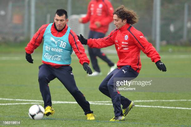 gary Medel and Manuel Iturra of Chile during a training at Spiserwies stadium November 13 2012 in Saint Gallen Switzerland Chile will play a friendly...