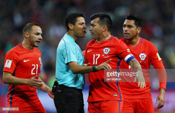 Gary Medel of Chile argues with Referee Alireza Faghani during the FIFA Confederations Cup Russia 2017 Group B match between Germany and Chile at...
