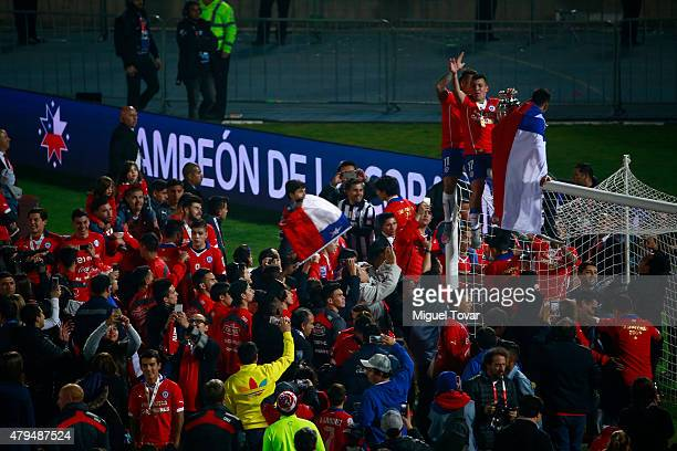 Gary Medel of Chile celebrate with the trophy after winning the 2015 Copa America Chile Final match between Chile and Argentina at Nacional Stadium...