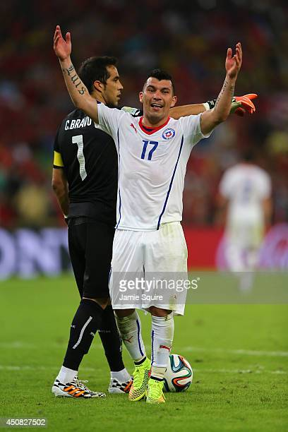 Gary Medel of Chile celebrates after defeating Spain 20 during the 2014 FIFA World Cup Brazil Group B match between Spain and Chile at Maracana on...