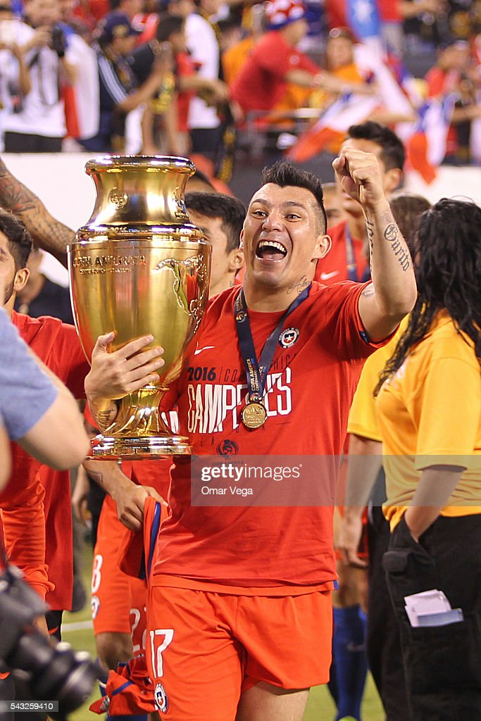 Gary Medel of Chile celebrates with the trophy after winning the championship match between Argentina and Chile at MetLife Stadium as part of Copa America Centenario US 2016 on June 26, 2016 in East Rutherford, New Jersey, US.