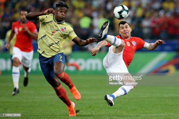 Gary Medel of Chile kicks the ball in the air against Duvan Zapata of Colombia during the Copa America Brazil 2019 quarterfinal match between...