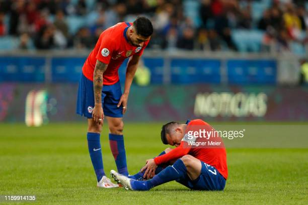 Gary Medel of Chile reacts after being injured during the Copa America Brazil 2019 Semi Final match between Chile and Peru at Arena do Gremio on July...