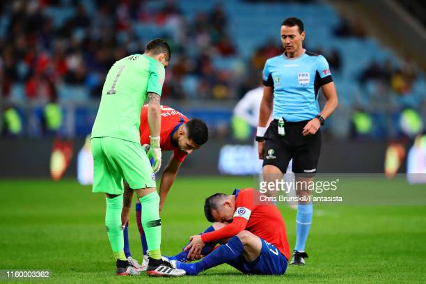 Gary Medel of Chile reacts to a challenge during the Copa America Brazil 2019 Semi Final match between Chile and Peru at Arena do Gremio on July 03...