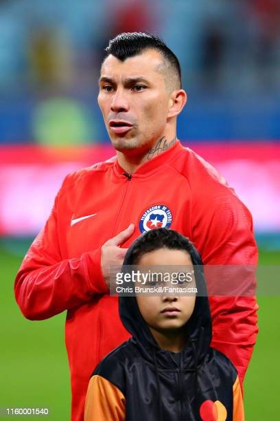 Gary Medel of Chile stands for the national anthem before the Copa America Brazil 2019 Semi Final match between Chile and Peru at Arena do Gremio on...