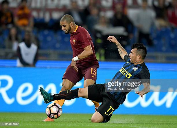 Gary Medel of FC Internazionale and Bruno Peres of AS Roma compete for the ball during the Serie A match between AS Roma and FC Internazionale at...