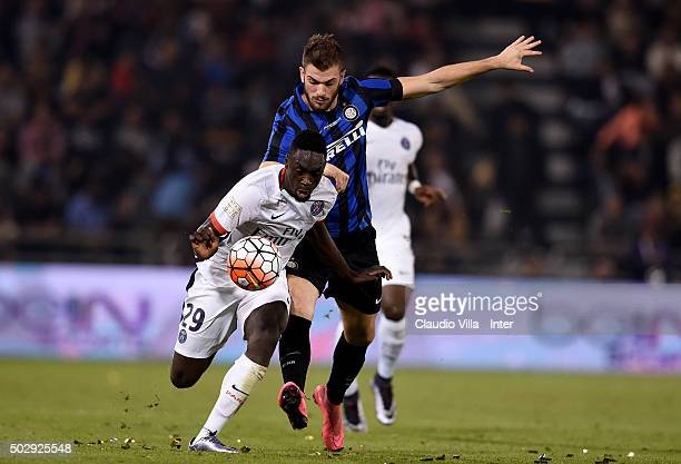 Gary Medel of FC Internazionale and Serge Aurier of Paris SaintGermain compete for the ball during the friendly match between FC Internazionale and...