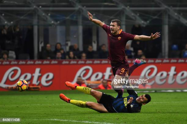 Gary Medel of FC Internazionale tackles Edin Dzeko of AS Roma during the Serie A match between FC Internazionale and AS Roma at Stadio Giuseppe...