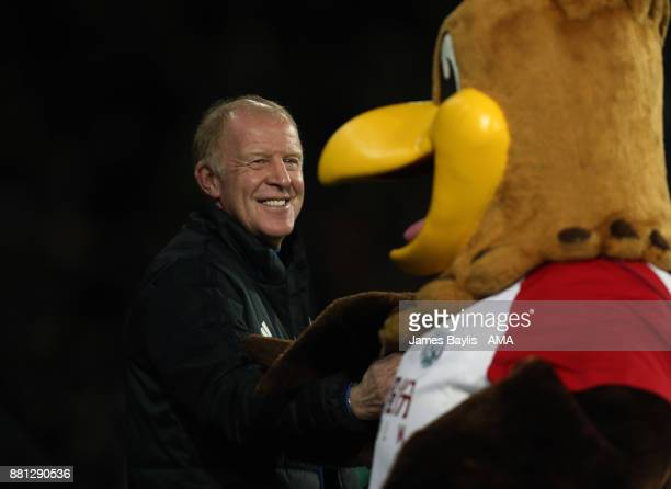Gary Megson the acting head coach / manager of West Bromwich Albion greets mascot Baggie Bird before the Premier League match between West Bromwich...