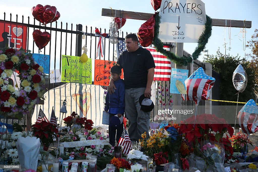 Gary Mendoza and his son Michael Mendoza walk around a make shift memorial near the Inland Regional Center as they pay their respects to those killed and injured on December 7, 2015 in San Bernardino, California. Law enforcement officials continue to investigate the mass shooting at the Inland Regional Center in San Bernardino that left 14 people dead and another 17 injured on December 2nd.
