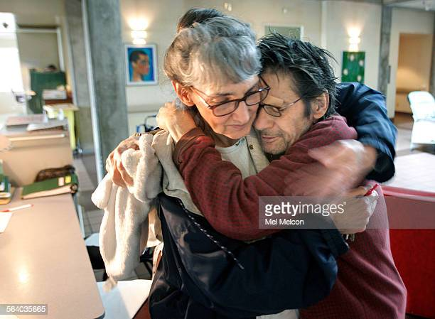 Gary Miller hospice patient with AIDS hugs Linda Irwin a licensed vocational nurse inside the Carl Bean House in Los Angeles the last AIDS hospice...
