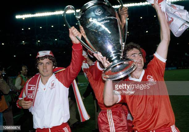 Gary Mills and Martin O'Neill of Nottingham Forest parade the trophy after their 10 victory over SV Hamburg in the European Cup Final at the Bernabeu...