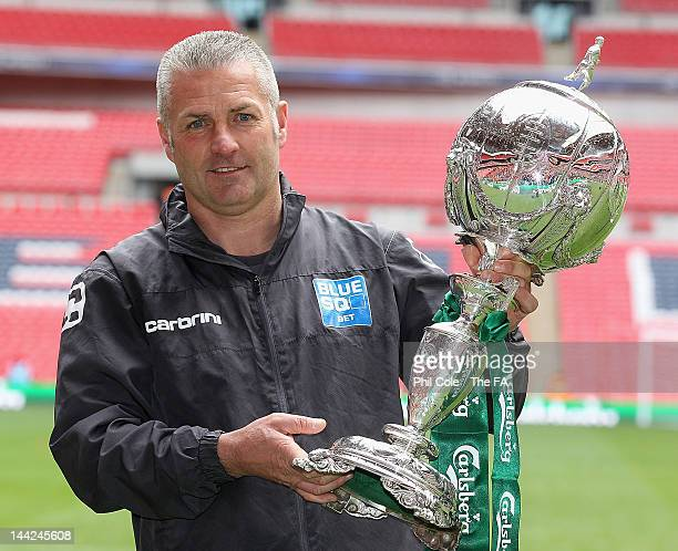 Gary Mills manger of York City holds the FA Carlsberg Trophy after winning the FA Trophy Final between York City and Newport Town at Wembley Stadium...