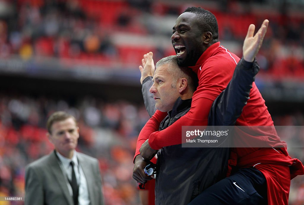 Gary Mills the manager of York City celebrates promotion to the football league during the Blue Square Bet Premier League Play Off Final at Wembley Stadium on May 20, 2012 in London, England.