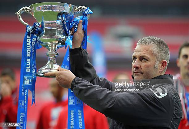 Gary Mills the manager of York City celebrates promotion to the football league during the Blue Square Bet Premier League Play Off Final at Wembley...