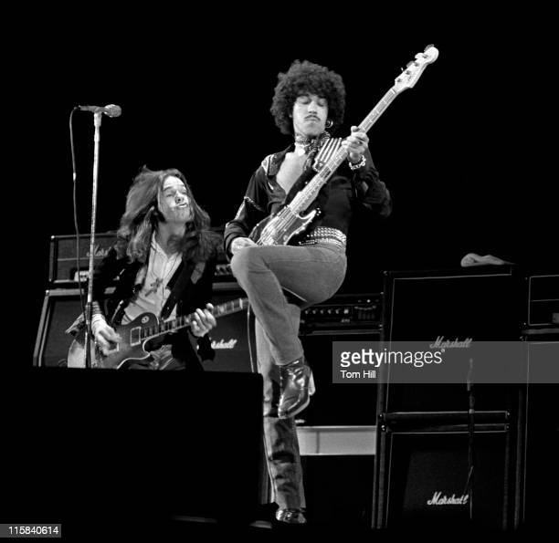 Gary Moore and Phil Lynott of Thin Lizzy performing onstage at Omni Coliseum
