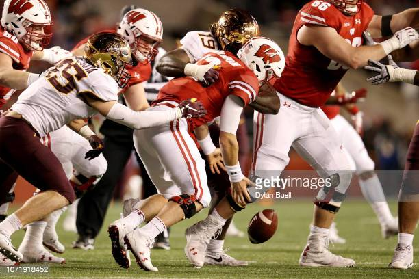 Gary Moore of the Minnesota Golden Gophers forces a fumble against Alex Hornibrook of the Wisconsin Badgers in the fourth quarter at Camp Randall...