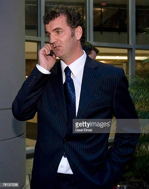 Gary Mulgrew makes a phone call after pleading guilty to wire fraud at the Bob Casey US Courthouse November 28 2007 in Houston Texas The former...