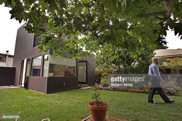 Gary Murphy makes his way past the guesthouse in the backyard at his and Jason La Padura's home Friday in Santa Monica July 28 2006 It's about living...