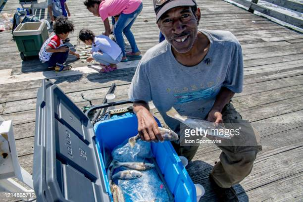 Gary Murrell of Norfolk Virginia shows off just a few of the fish he caught off of the Virginia Beach Fishing Pier on May 22 in Virginia Beach VA...