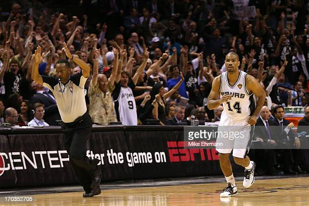 Gary Neal of the San Antonio Spurs reacts after making a threepointer in the fourth quarter while taking on the Miami Heat during Game Three of the...
