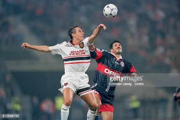 Gary Neville and Ali Daei during the 19981999 Champions League round match between Bayern Munich and Manchester United