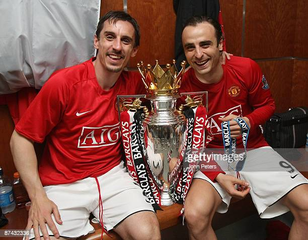 Gary Neville and Dimitar Berbatov of Manchester United celebrates with the Premier League trophy in the dressing room after the Barclays Premier...