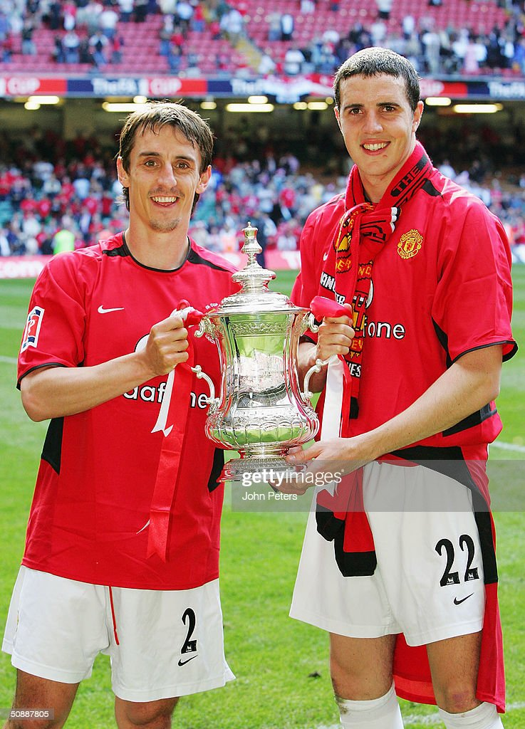 Gary Neville and John O'Shea of Manchester United celebrate with the FA Cup after winning the AXA FA Cup Final between Manchester United and Millwall at the Millennium Stadium on May 22, 2004 in Cardiff, Wales.