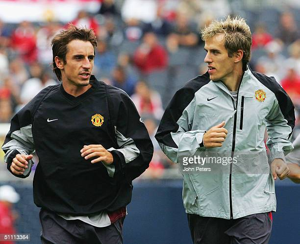 Gary Neville and Phil Neville of Manchester United who have just signed new fiveyear contracts with the club in action during a training session at...