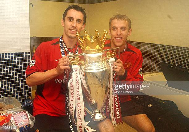 Gary Neville and Phillip Neville with the Premiership Trophy after the FA Barclaycard Premiership match between Everton v Manchester United at...