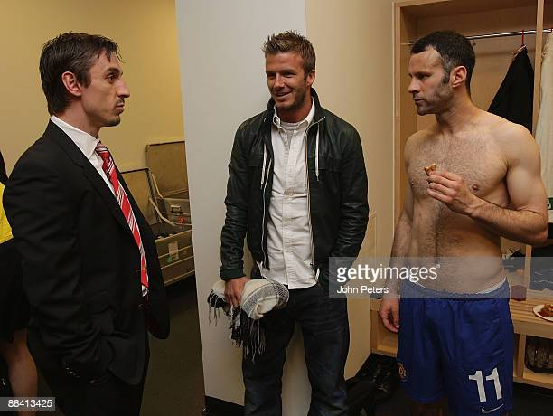 Gary Neville and Ryan Giggs of Manchester United celebrate in the dressing room with David Beckham after the UEFA Champions League SemiFinal Second...