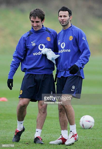 Gary Neville and Ryan Giggs of Manchester United in action during a first team training session at Carrington Training Ground on January 6 2006 in...