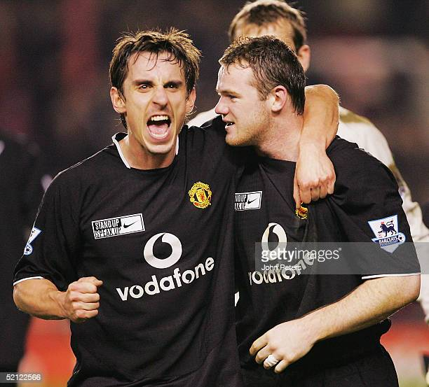 Gary Neville and Wayne Rooney of Manchester United celebrate after the Barclays Premiership match between Arsenal and Manchester United at Highbury...