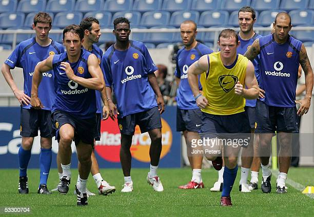 Gary Neville and Wayne Rooney of Manchester United in action during a first team training session at Saitama Stadium on July 29, 2005 in Saitama,...